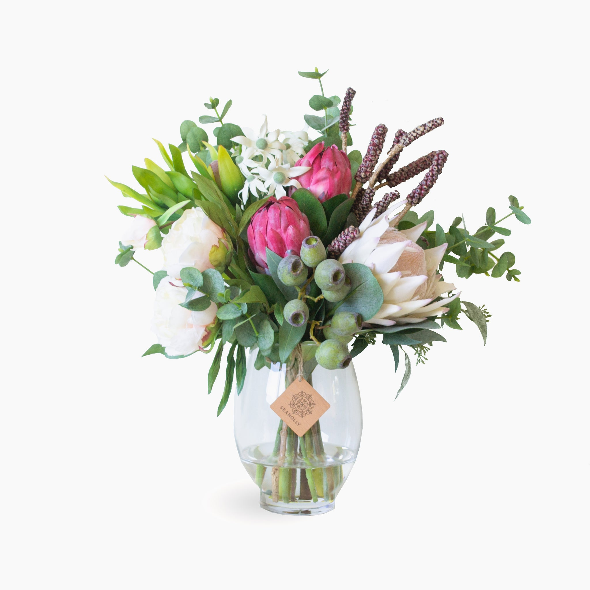 Queen protea, peony and leucadendron with flannel flowers and bottlebrush pods