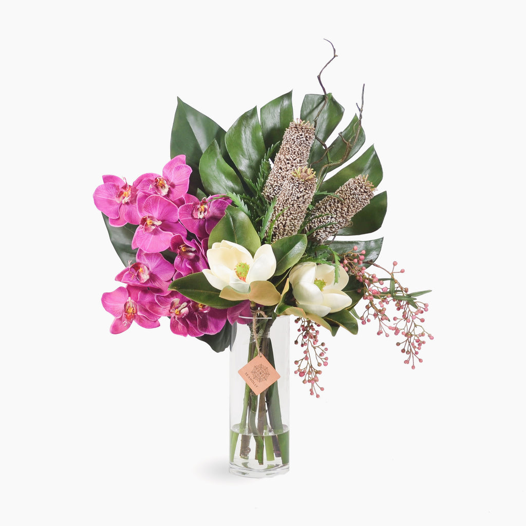 Fuschia phalaenopsis, pencil banksia and magnolia with pepper berry