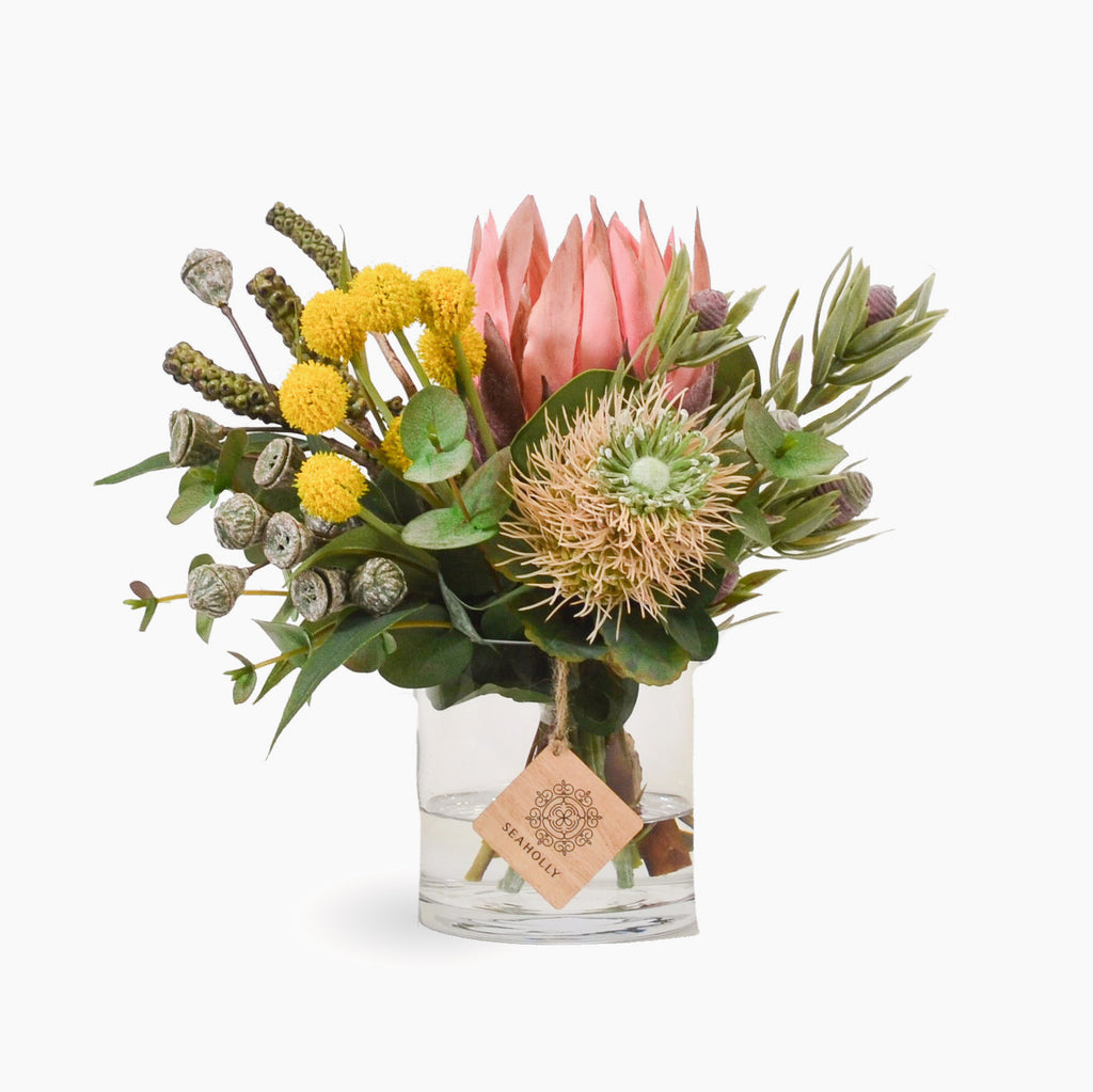Pink protea, leucospermum, billy buttons and mixed native foliages