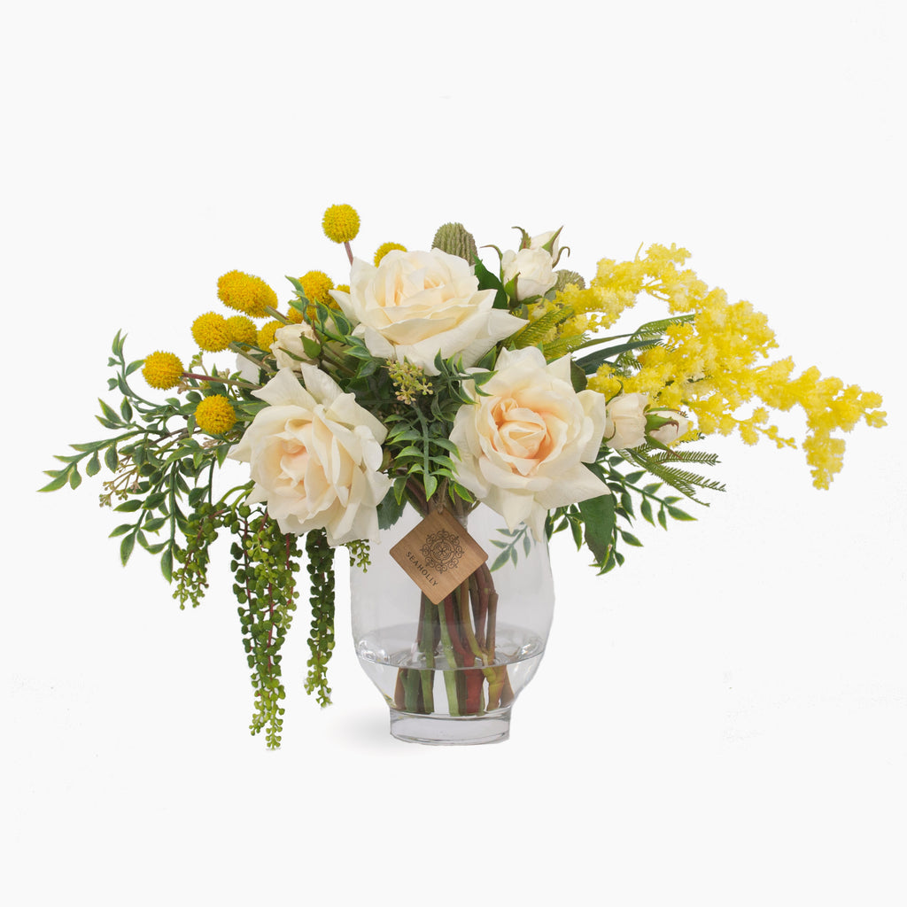 Cream roses, peony, billy buttons, mimosa and hanging berries
