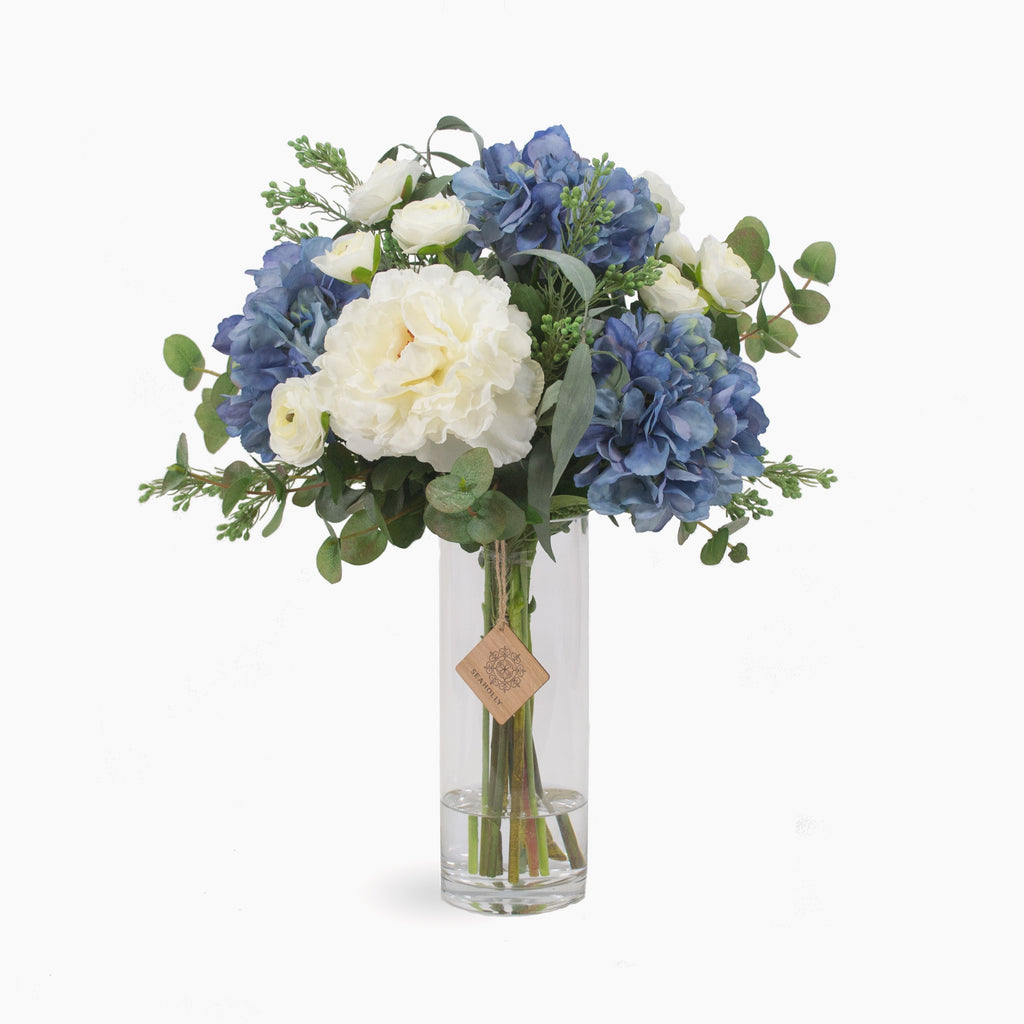 Blue hydrangea, peonies, ranunculus and wax flower seeds