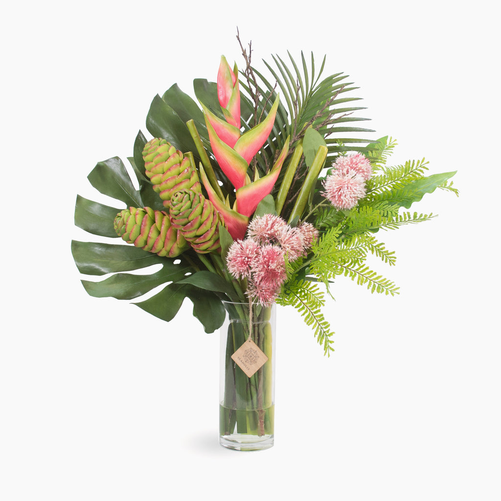 Heliconia, beehive gingers and sweet gum blossom with mixed tropical leaves