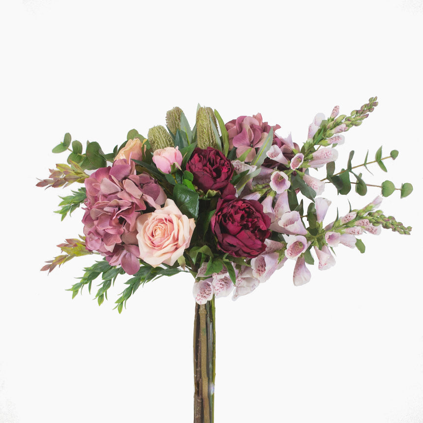 Foxglove, hydrangea, peony, banksia and rose with mixed greenery