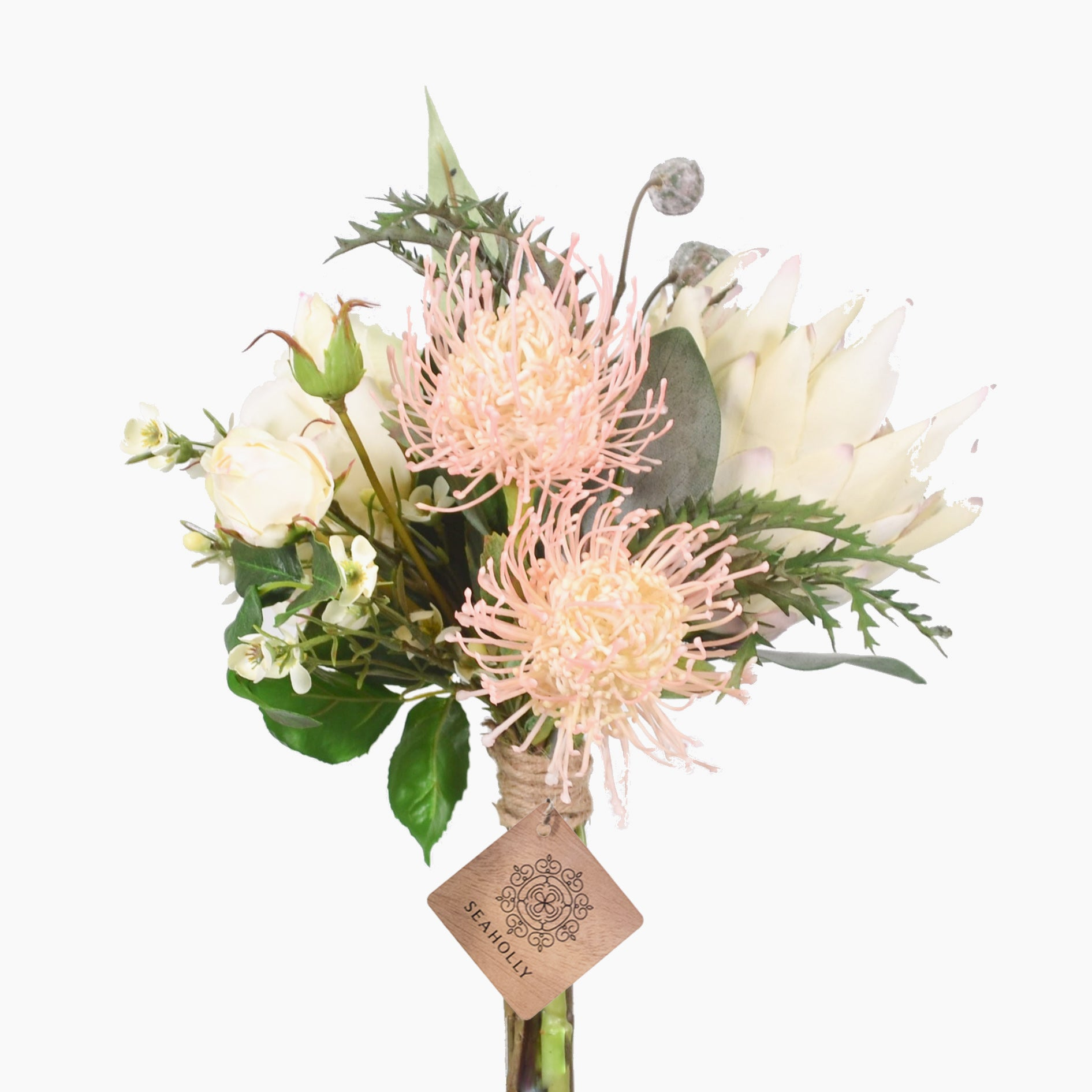 Cream king protea, wax flowers, rose and eucalyptus pods