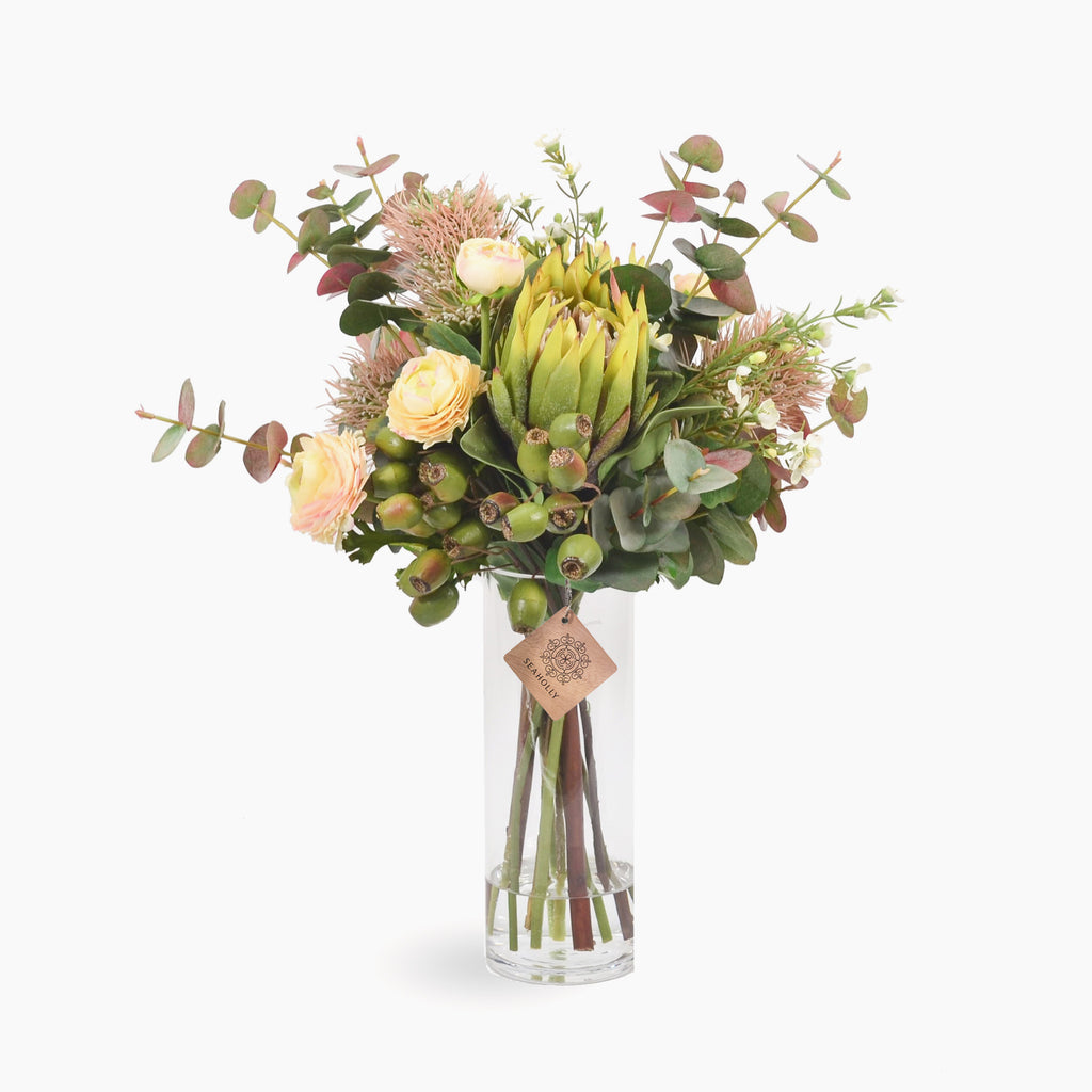 Green protea, leucospermum and ranunculus with wax flower and gumnuts