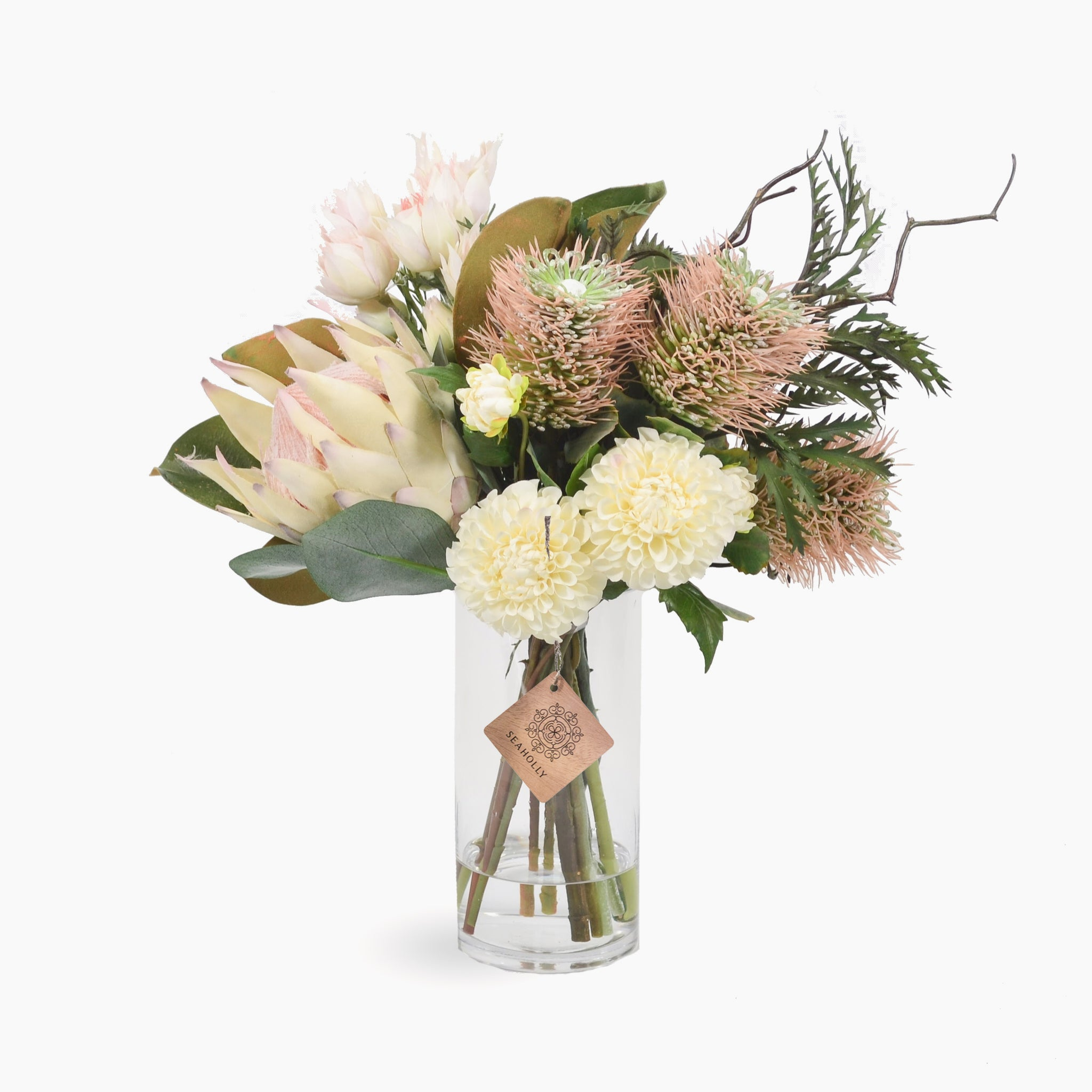 Cream protea, leucospermum and blushing brides with dahlia