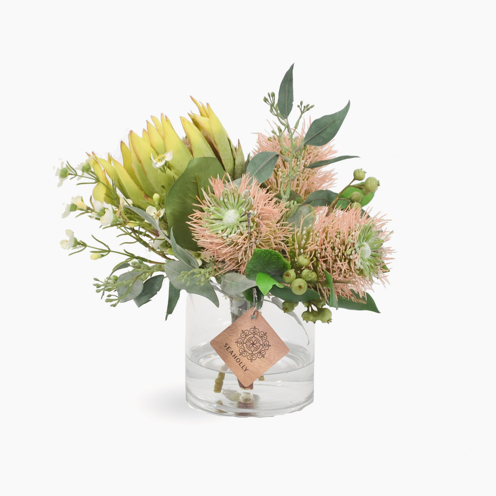 Green protea, pink leucosopermum, wax flower and berries