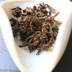Smoked Lapsang Souchong wet leaves