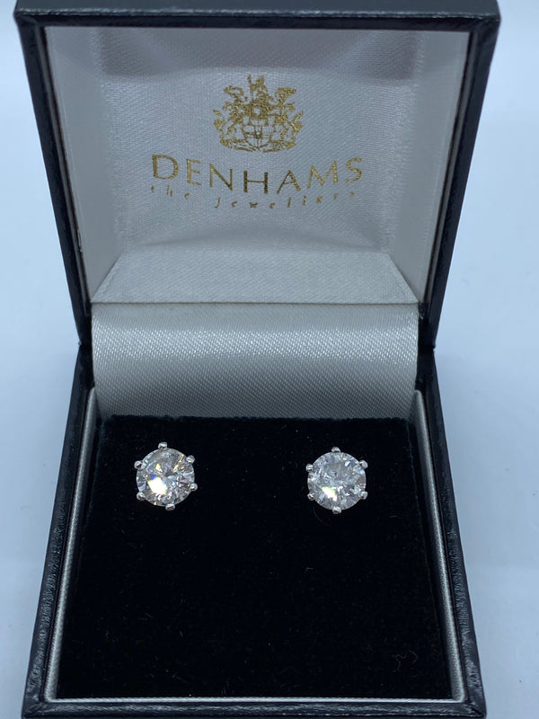 One pair of single stone diamond earrings