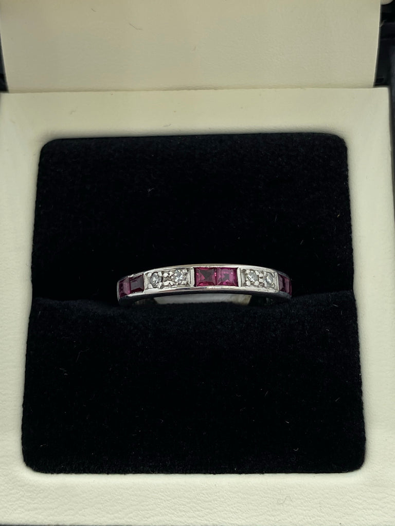 Ten stone ruby and diamond eternity ring 18ct white gold