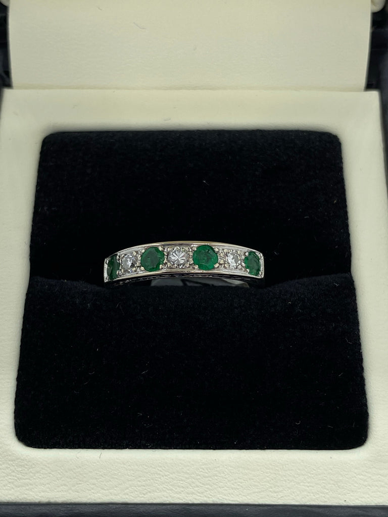 Seven stone emerald and diamond eternity ring 18ct white gold