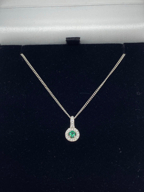 Emerald and diamond cluster pendant 18ct white gold