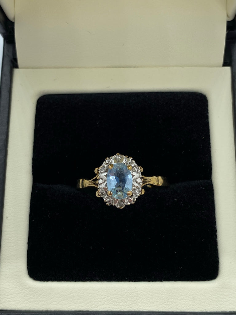 Aquamarine and diamond cluster ring 9ctyellow gold