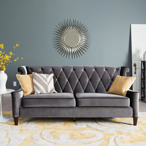 Elegant grey sofa with silver mirror