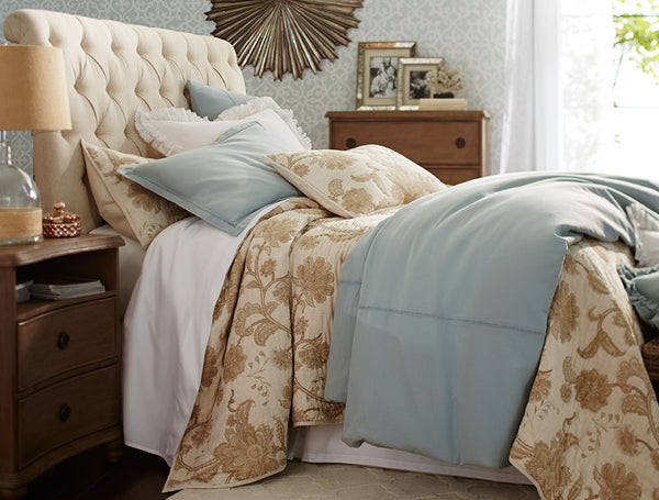 Disguise your divan bed base with a fitted valance or bed skirt