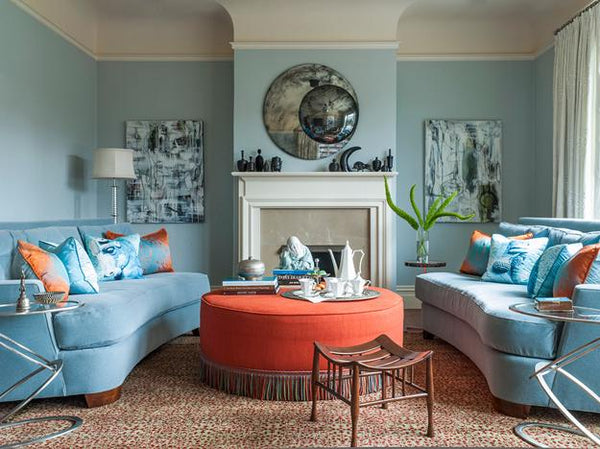 Blue sofa and orange ottoman