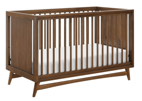 How to decorate a nursery - choosing a mid-century modern crib. A dark brown crib with clean lines.