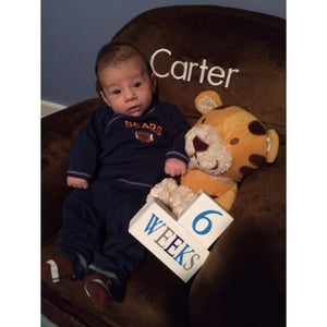 Baby Carter in Rocker with baby age blocks