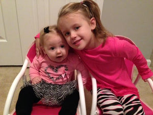 Sweet Sisters in Matching Rocking Chairs