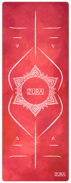 A dark red watercolor suede yoga mat with eight hand-drawn white lines that indicate placement of hands and feet along with a white mandala surrounding the ZURA brand logo in the center.