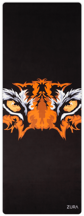 A black yoga mat with a tiger face in the center.