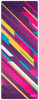 A suede yoga mat covered with lots of pink, yellow, blue, purple, and white stripes angled at 45 degrees with varying widths and lengths.