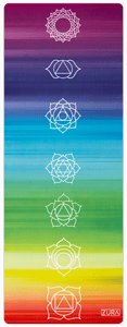 A suede yoga mat with horizontal rainbow stripes and white chakra symbols lined up across the vertical center.
