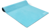 A turquoise suede yoga mat with a white om symbol at the bottom edge, displayed halfway rolled out.