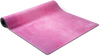 A pink vignette suede yoga mat, displayed halfway rolled out