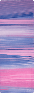 A suede yoga mat covered with dark pastel pink and blue brush strokes.