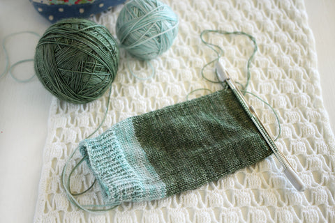 spruce socks wip - october house fiber arts journal