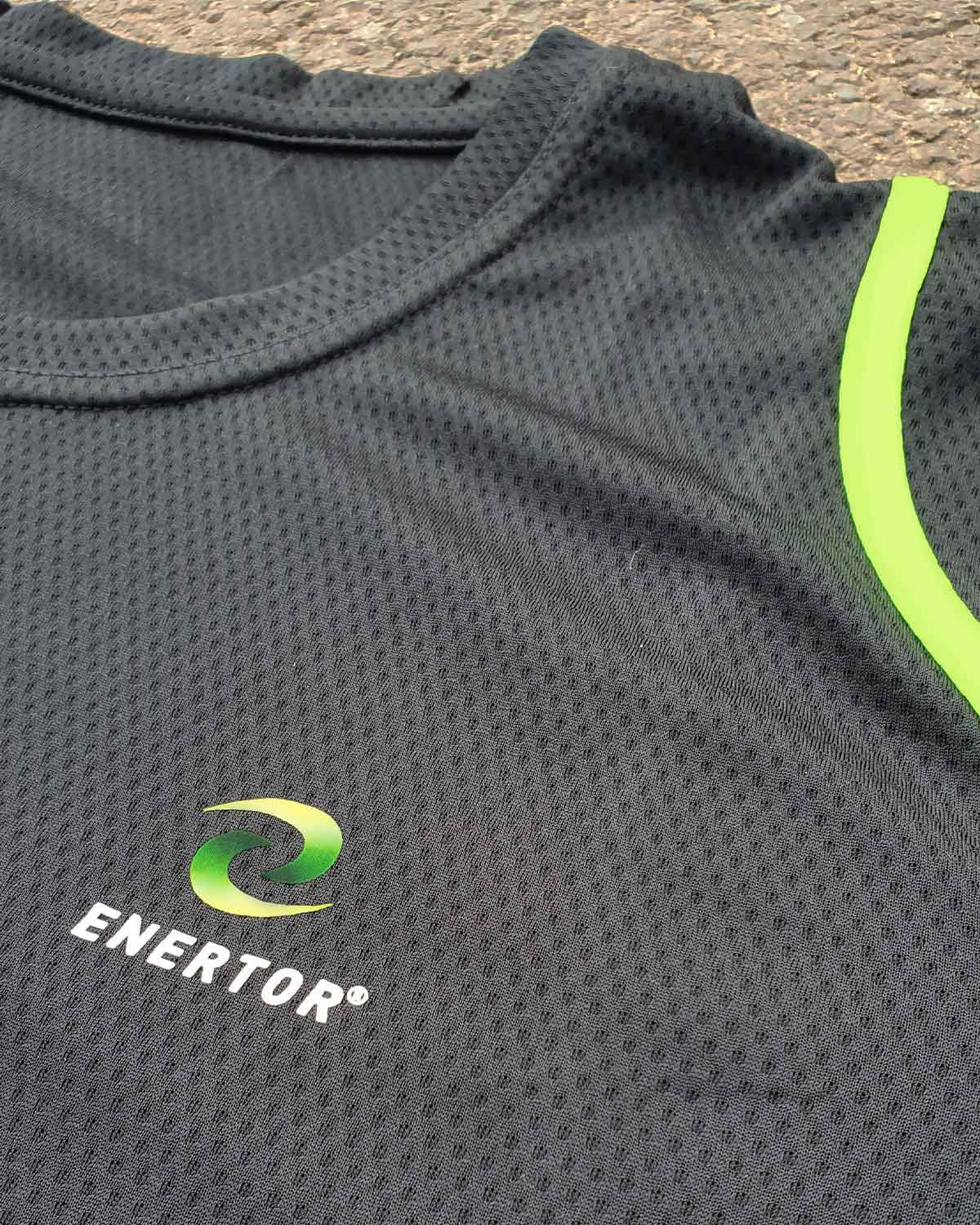 Enertor Breathable T-shirt Logo Top With Green Luminous Stripes in black close up ground shot
