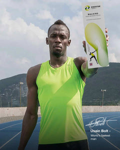 Usain Bolt holding Enertor Walking Insoles - Twin Pack