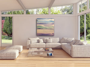 ocean and mountain painting in living room