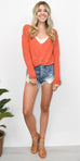 Free People Got Me Twisted Sweater in Orange