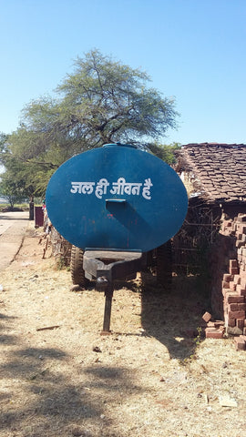Water truck with Hindi script, translation: Water is life