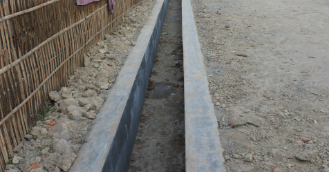 A new concrete drain at Borbeta Village in Chota Tingrai Tea Estate