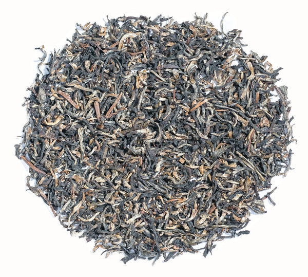 Aureate and Charcoal leaves of Assam Golden Tips tea direct from Chota Tingrai Tea Estate