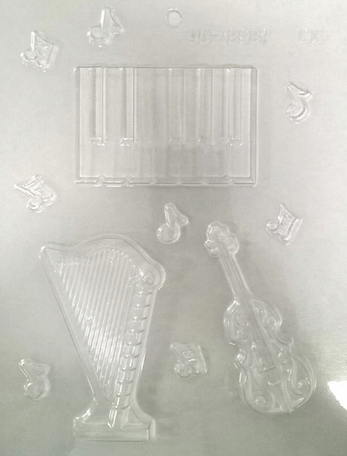 Plastic chocolate mould. Keyboard, harp & violin with very small quaver notes. 90-13982