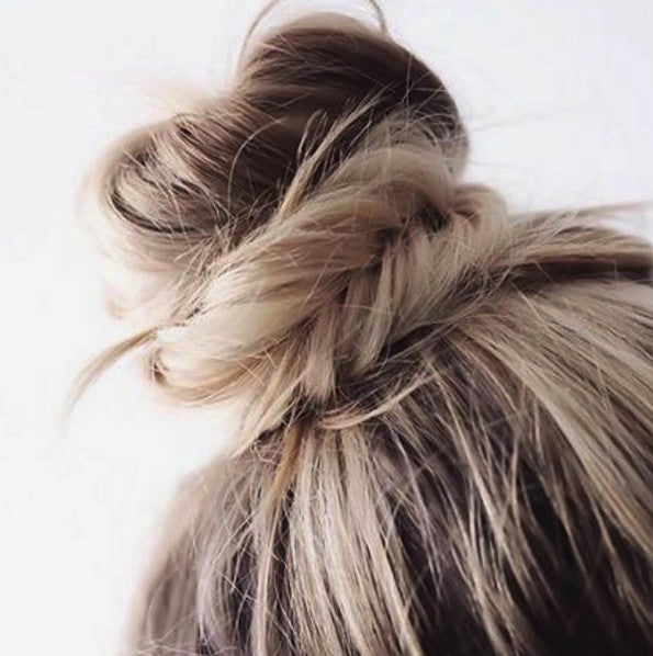 Messy top-knot bun hairstyle