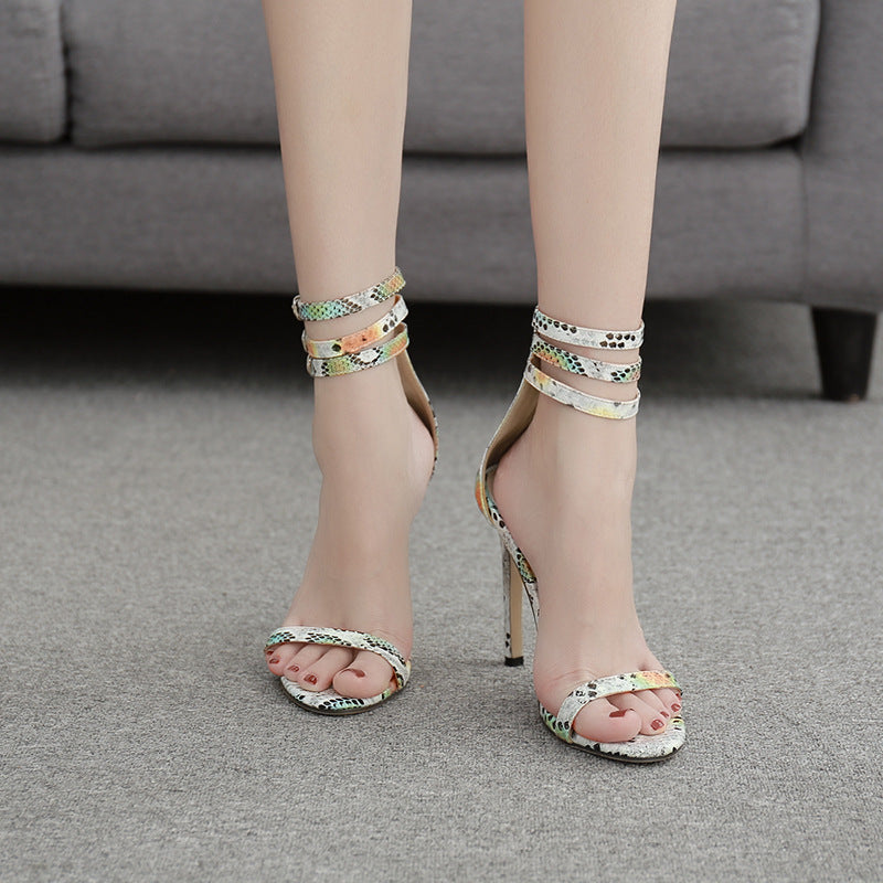 Women's sandals with thin colored snake pattern and high heels