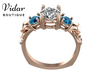3 Stone Rose Gold Engagement Ring With Blue Diamonds