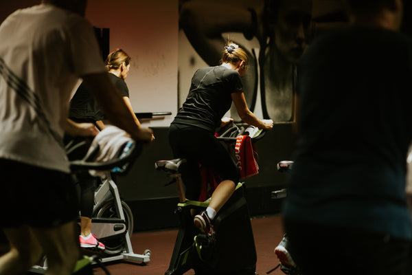 Some cyclists are working out in a gym.