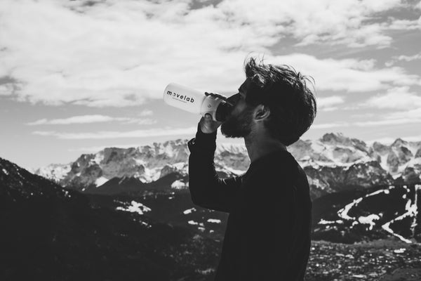 Athlete drinking water to hydrate