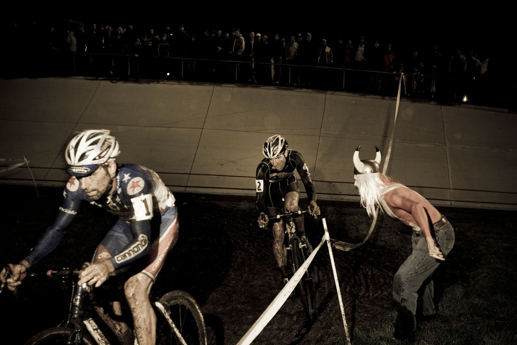 Two cyclists are competing with each other during a Cyclocross event.