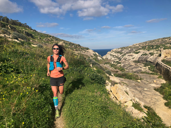 Ultra Marathon runner Anna Marie-Watson running in the mountains.