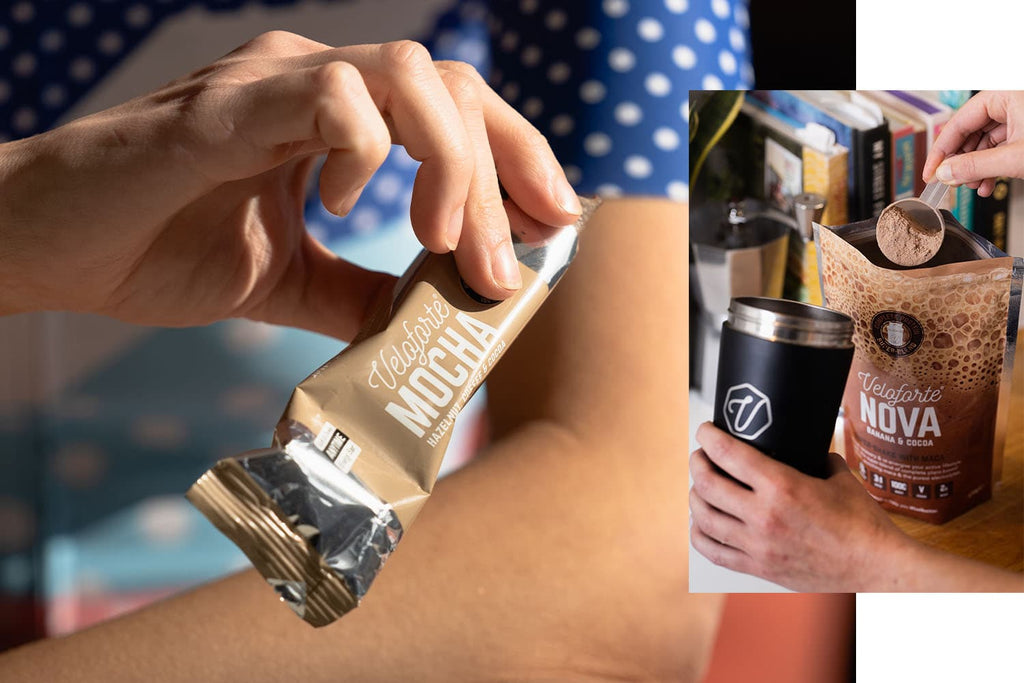 Woman holding an energy bar for swimming nutrition