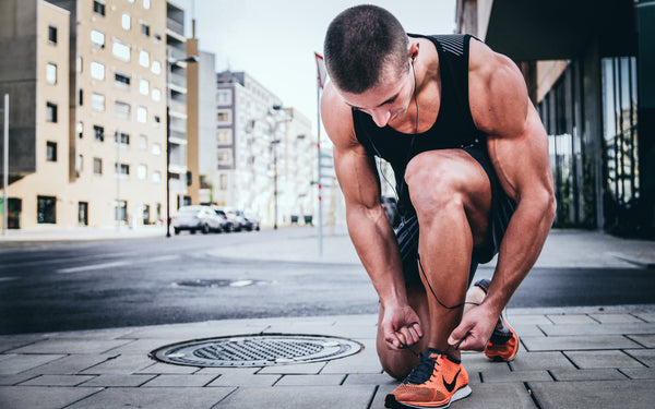 Triathlete runner tying his shoe laces