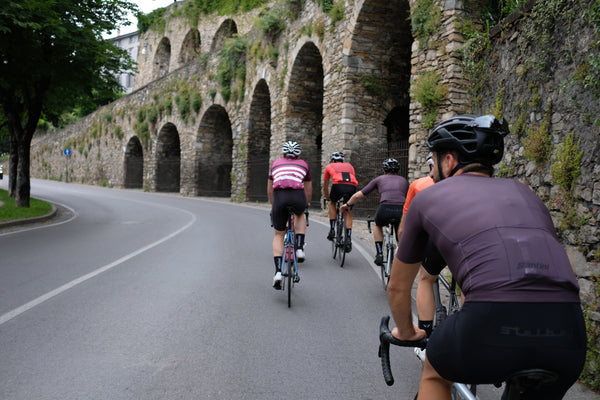 A group of cyclists are riding together.
