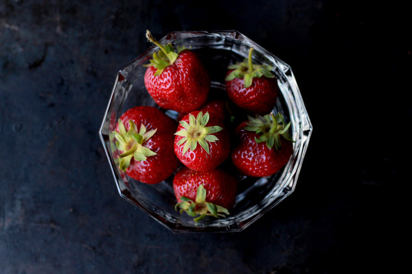 Fresh strawberries in a bowl.